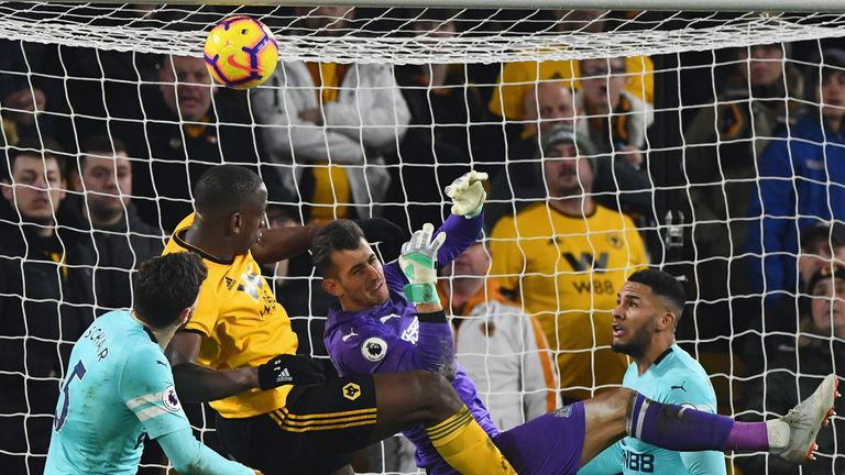 Willy Boly of Wolverhampton Wanderers outjumps goalkeeper Martin Dubravka of Newcastle United as he scores his team's first goal during the Premier League match between Wolverhampton Wanderers and Newcastle United at Molineux on February 11, 2019 in Wolverhampton, United Kingdom.