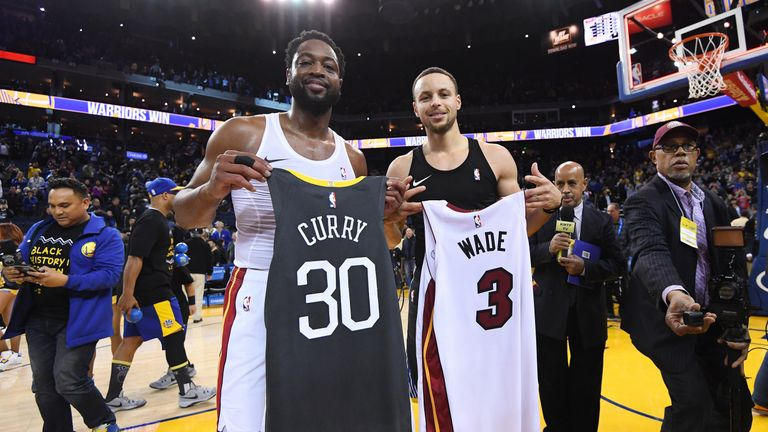 Dwayne Wade and Steph Curry swap jerseys after the game