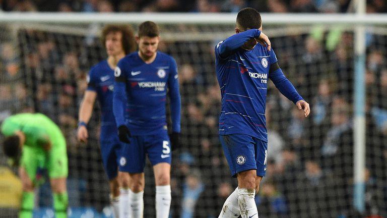 Chelsea midfielder Eden Hazard reacts after Manchester City's fifth