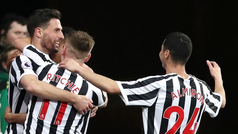 Fabian Schar of Newcastle United (L) celebrates after scoring his team's first goal