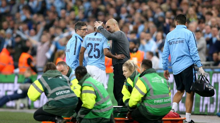Fernandinho (centre) speaks to Manchester City manager Pep Guardiola as he comes off in the Carabao Cup final
