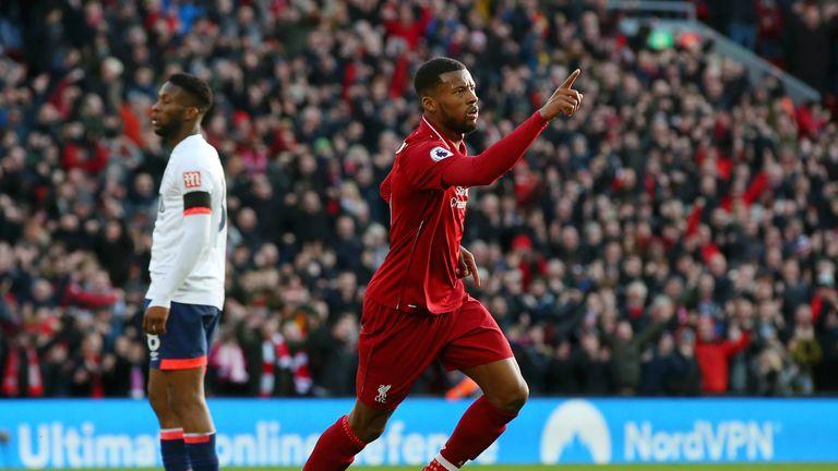 Georginio Wijnaldum celebrates after scoring Liverpool 's second goal