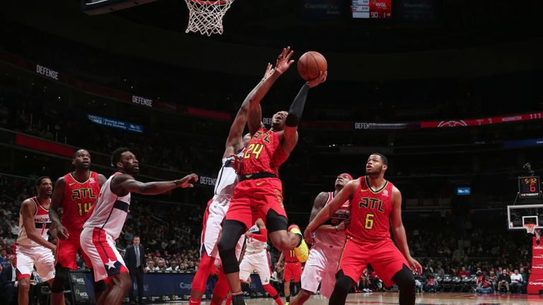 Kent Bazemore of the Atlanta Hawks goes to the basket against the Washington Wizards