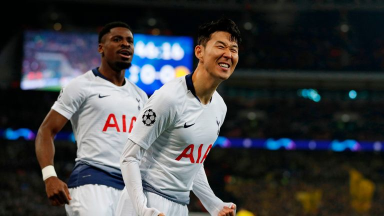 Heung -min Son celebrates with Serge Aurier after scoring Tottenham's opening goal