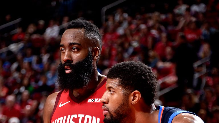 James Harden #13 of the Houston Rockets on guard against Paul George #13 of the Oklahoma City Thunder on December 25, 2018 at the Toyota Center in Houston, Texas.