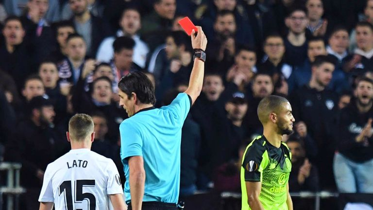 Celtic's Jeremy Toljan is shown a red card during the Europa League last-32 second leg against Valencia