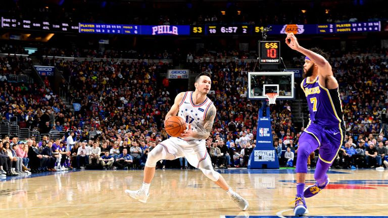 JJ Redick of the Philadelphia 76ers handles the ball against the Los Angeles Lakers
