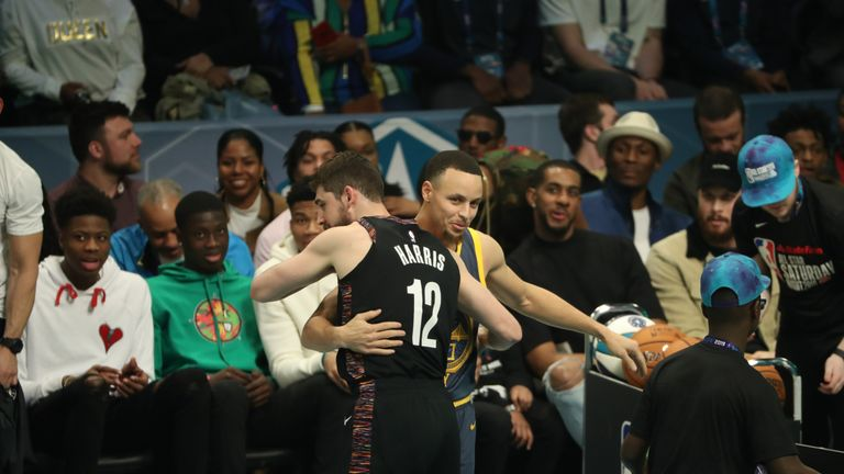 Joe Harris #of the Brooklyn Nets hugs Stephen Curry of the Golden State Warriors during the 2019 3-Point Contest as part of All-Star Saturday Night