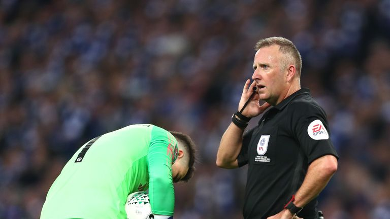 John Moss tries to get clarification over Kepa Arrizabalaga's substitution during the Carabao Cup final
