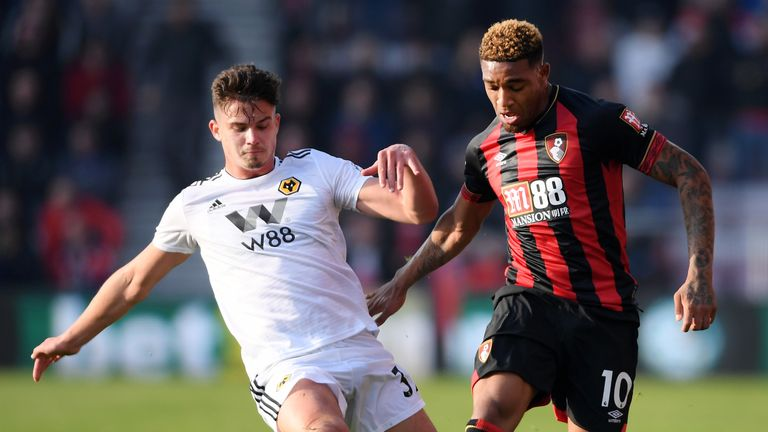 Bournemouth's Jordon Ibe is challenged by Wolves' Leander Dendoncker