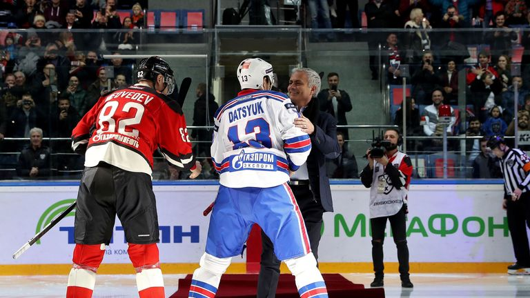 He was helped back to his feet by legendary Russian player Pavel Datsyuk