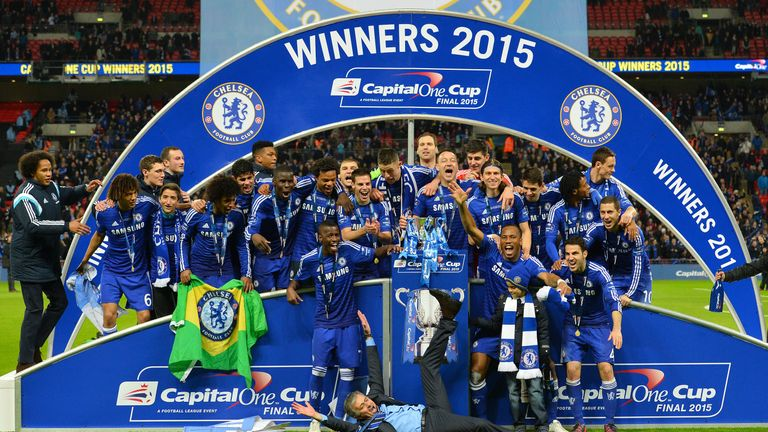 Mourinho slides on the floor as Chelsea celebrate their League Cup win over Spurs