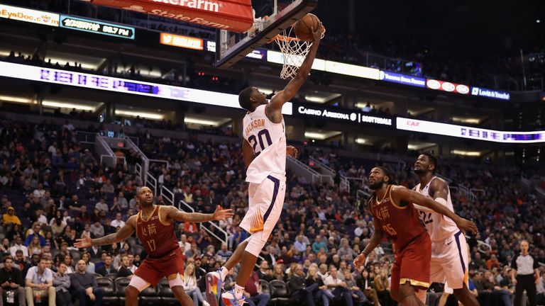 Josh Jackson of the Phoenix Suns attempts a shot ahead of PJ Tucker of the Houston Rockets