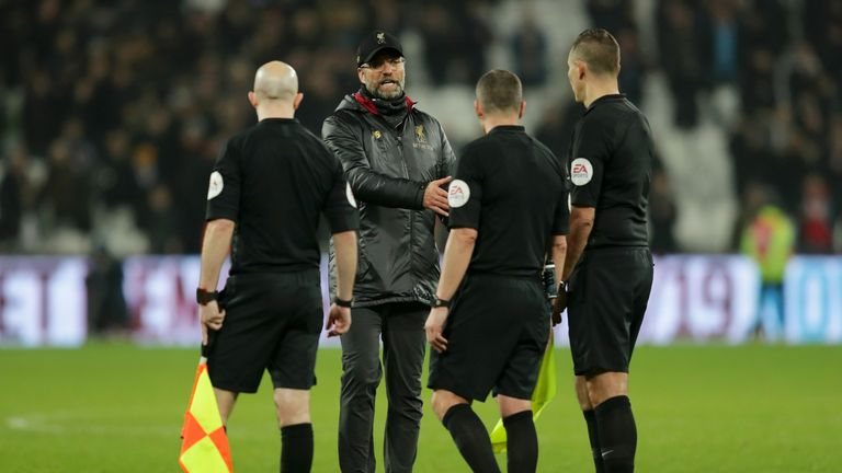 Jurgen Klopp approaches referee Kevin Friend and assistant referees Matthew Wilkes and Simon Beck at full-time