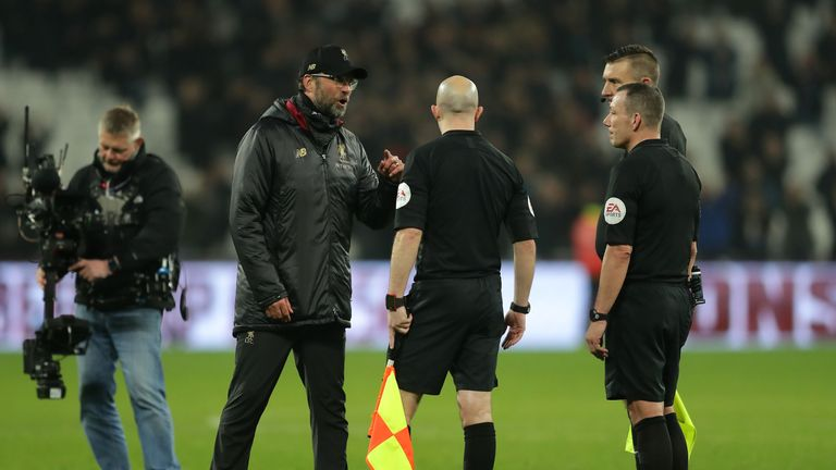 Jurgen Klopp speaks to referee Kevin Friend and assistant referees Matthew Wilkes and Simon Beck following the 1-1 draw with West Ham