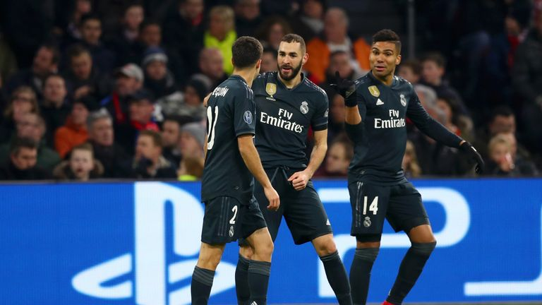 Karim Benzema (centre) celebrates scoring for Real Madrid against Ajax