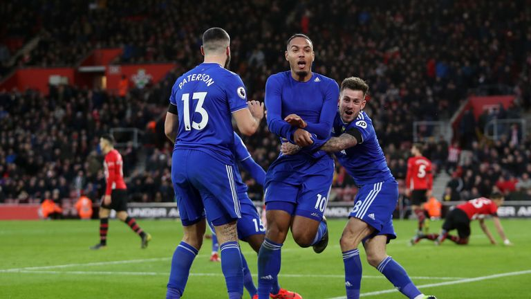Zohore is mobbed by Cardiff team-mates following his injury-time winner at St Mary's