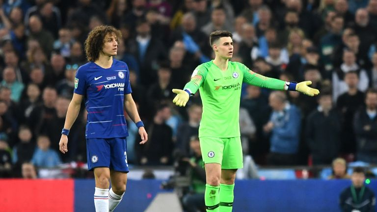 Kepa Arrizabalaga throws his arms out in frustration and refuses to be substituted during the Carabao Cup Final