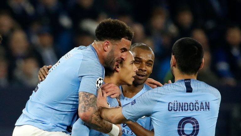 Leroy Sane celebrates with his team-mates after scoring for Manchester City against Schalke in the Champions League