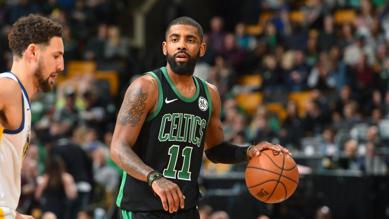 Kyrie Irving #11 of the Boston Celtics handles the ball against the Golden State Warriors on January 26, 2019 at the TD Garden in Boston, Massachusetts.
