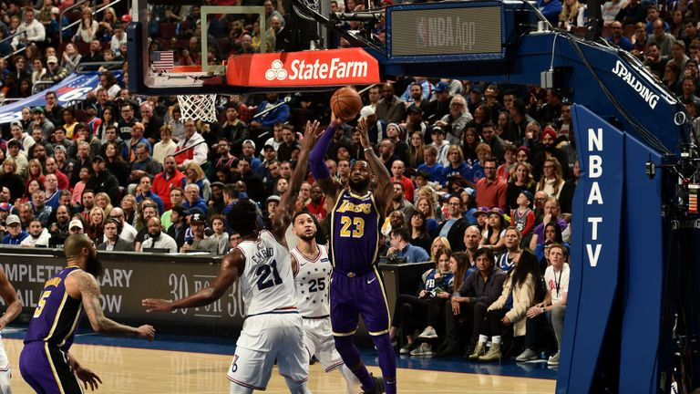 LeBron James of the Los Angeles Lakers shoots the ball against the Philadelphia 76ers