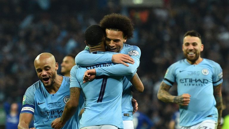 Leroy Sane embraces Manchester City's match-winner Raheem Sterling