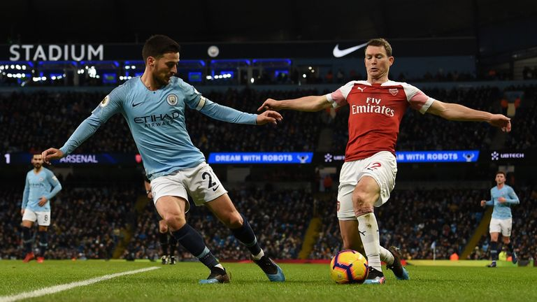 Stephan Lichtsteiner (right) suffered a torrid day against Manchester City