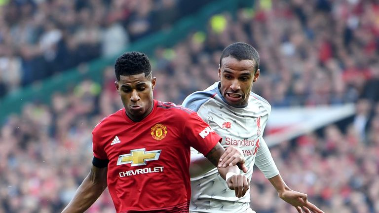 Marcus Rashford and Joel Matip compete for possession