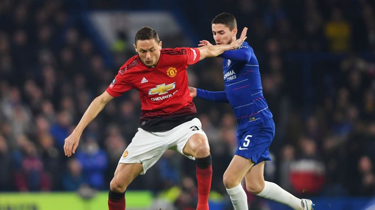 Nemanja Matic holds off Jorginho in the opening stages