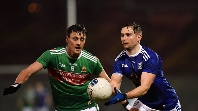Stephen Murray of Cavan is watched by Diarmuid O'Connor of Mayo