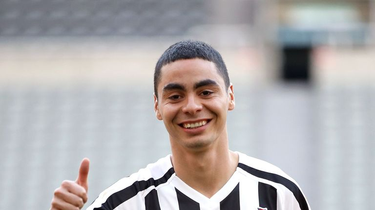 Newcastle United's new signing Miguel Almiron poses on the pitch at St James' Park after his press conference