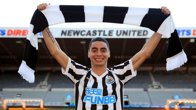 Newcastle United's new signing Miguel Almiron poses for photos on the pitch at St James' Park after his press conference