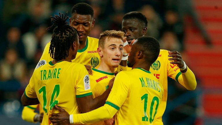 Nantes midfielder Valentin Rongier (C) celebrates with team-mates after scoring a penalty against Caen