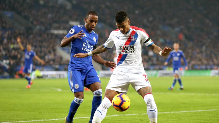 Crystal Palace's Patrick van Aanholt (right) and Leicester City's Ricardo Pereira battle for the ball during the Premier League match at the King Power Stadium, Leicester, Saturday 23 February 2019