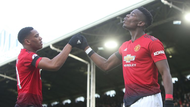 Pogba celebrates his first goal with Martial