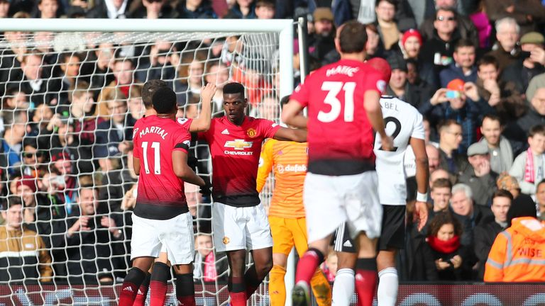 Paul Pogba celebrates with team-mates after scoring Manchester United's third goal