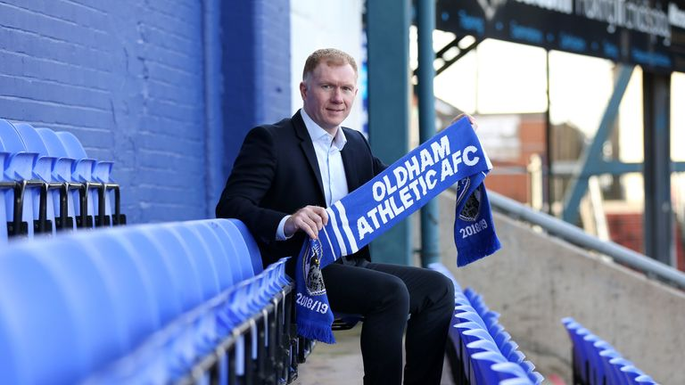 New Oldham Athletic manager Paul Scholes poses for photos after his press conference at Boundary Park