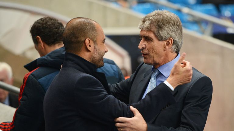 Manuel Pellegrini (R), coach of Manchester City greets Josep Guardiola, coach of Muenchen during the UEFA Champions League Group D match between Manchester City and FC Bayern Muenchen at Etihad Stadium on October 2, 2013 in Manchester, England.