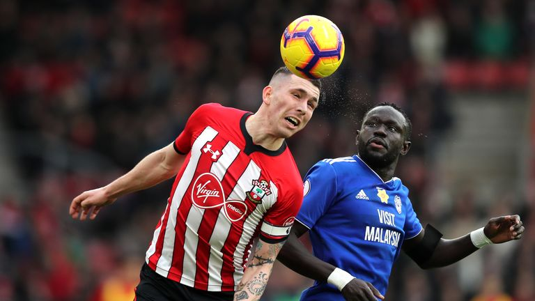 Pierre-Emile Hojbjerg battles for possession in the air with Oumar Niasse