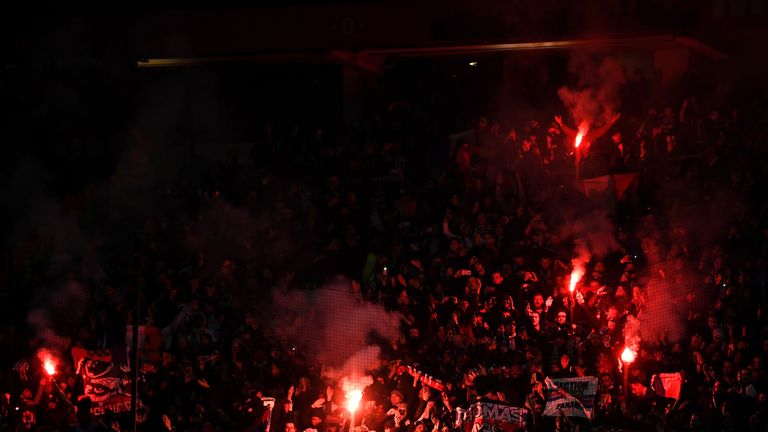 PSG's fans appeared to set of flares at Old Trafford