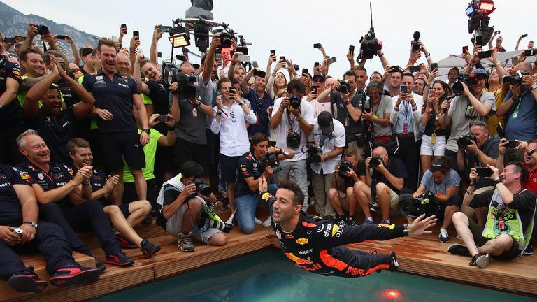 Daniel Ricciardo dives into the Red Bull pool after his 2018 Monaco GP victory