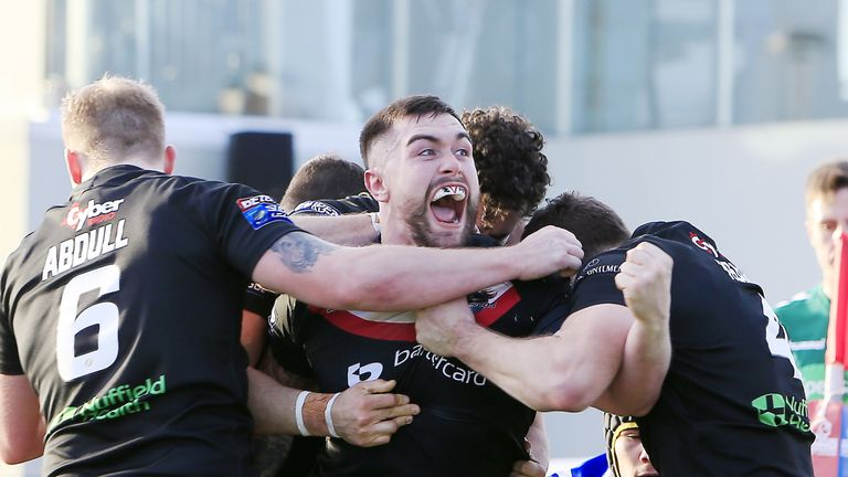 London Broncos' Matty Fozard celebrates a score against Super League rivals Wakefield