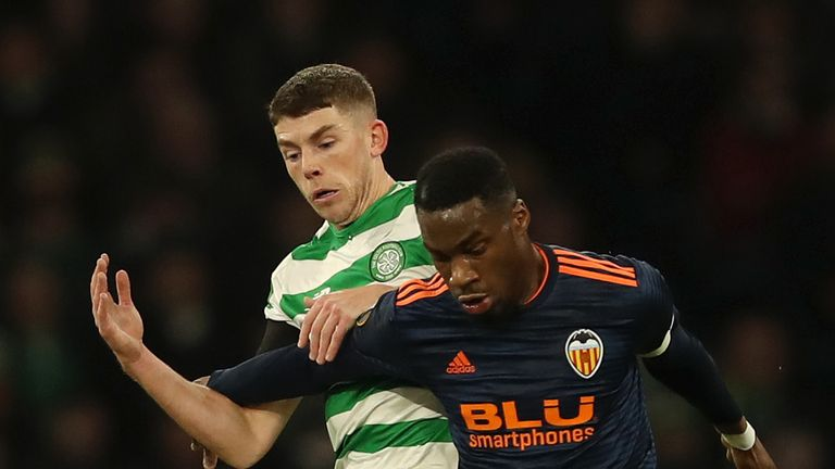 Ryan Christie of Celtic battles for possession with Geoffrey Kondogbia