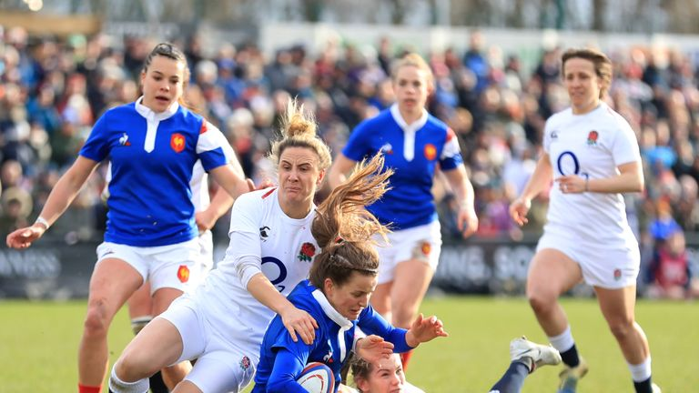 England's Sarah McKenna tackles Camille Imart of France at Doncaster
