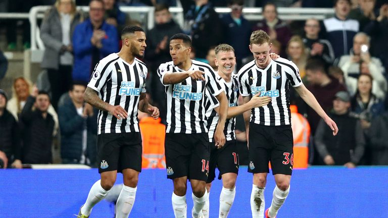 Sean Longstaff (R) celebrates with team-mates after doubling Newcastle's lead