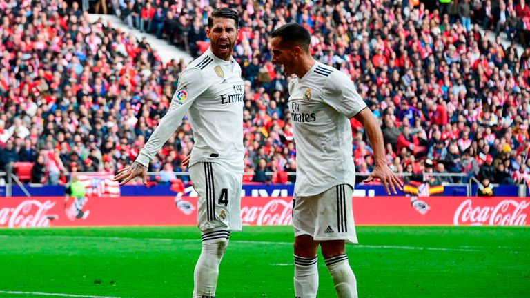 Sergio Ramos (L) celebrates his penalty as Real move above Atletico into second in La Liga