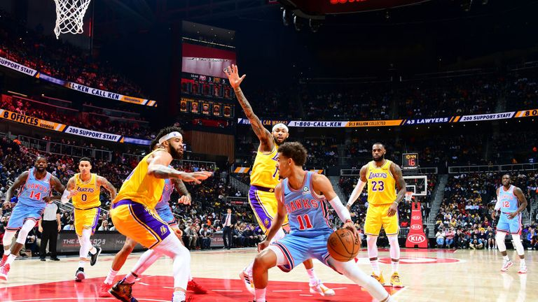 Trae Young of the Atlanta Hawks handles the ball against the Los Angeles Lakers