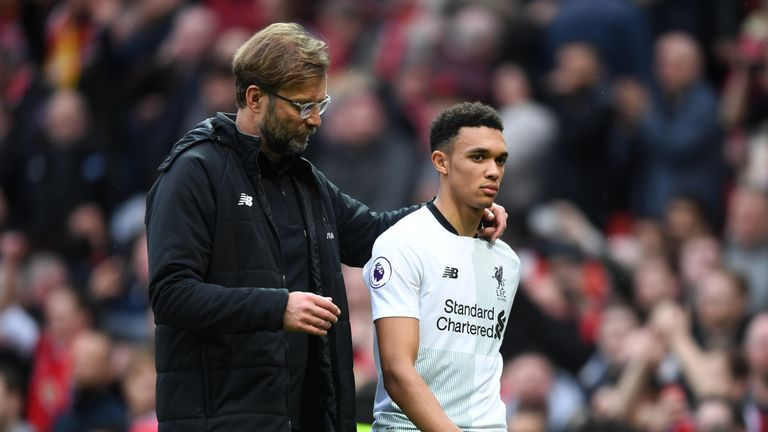 Trent Alexander-Arnold is consoled by Jurgen Klopp after a tough game at Old Trafford in March 2018