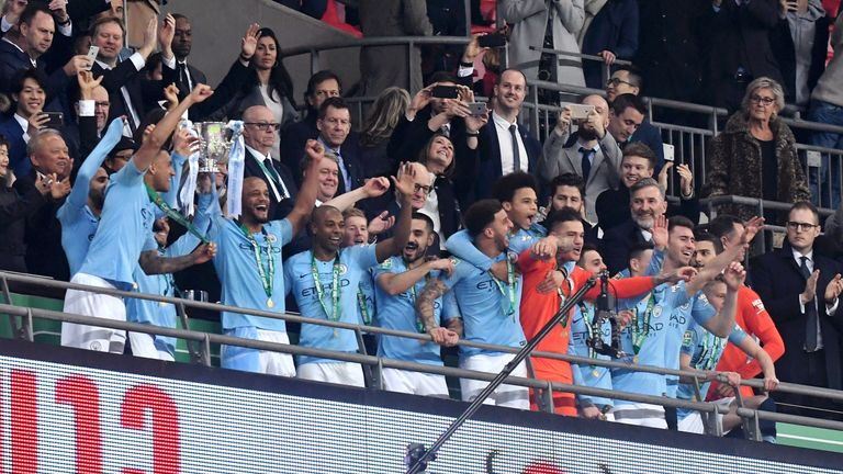 Vincent Kompany and David Silva lift the Carabao Cup trophy at Wembley Stadium