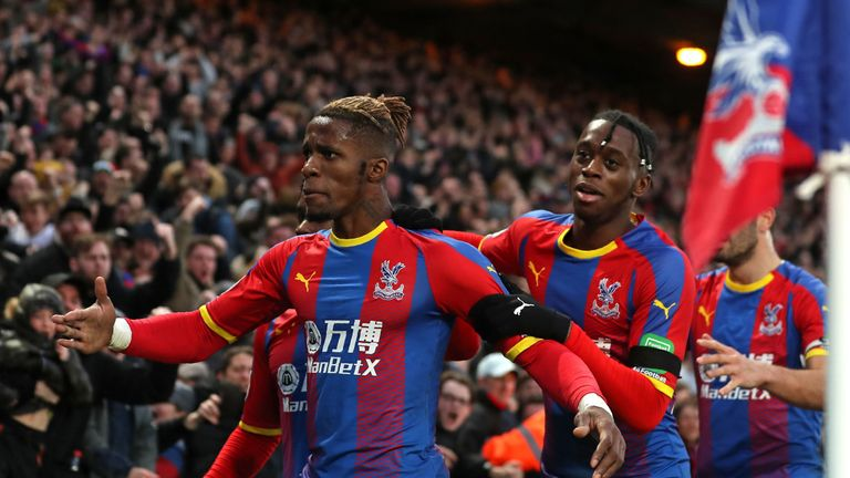 Wilfried Zaha celebrates with Crystal Palace team-mates